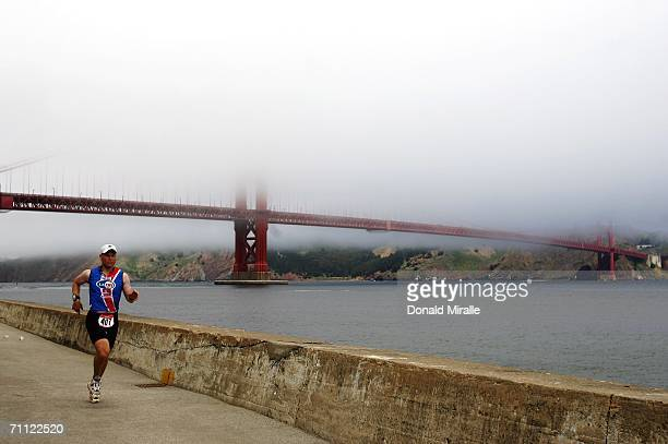 Brett Kennedy runs on the Marina with the Golden Gate in the background during the Escape from Alcatraz Triathlon on June 4 2006 in San Francisco...