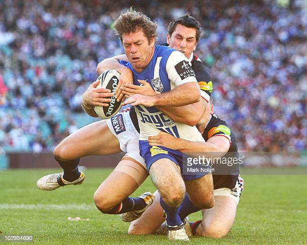 Brett Kimmorely of the Bulldogs is tackled during the round 19 NRL match between the Sydney Roosters and the Canterbury Bulldogs at the Sydney...