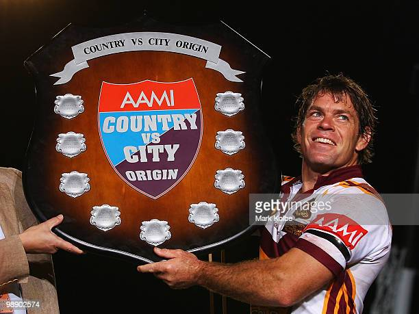 Brett Kimmorley of Country holds the shield after Country won the ARL Origin match between Country and City at Regional Sports Stadium on May 7, 2010...