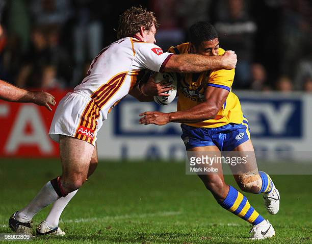Brett Kimmorley of Country tackles Michael Jennings of City during the ARL Origin match between Country and City at Regional Sports Stadium on May 7,...