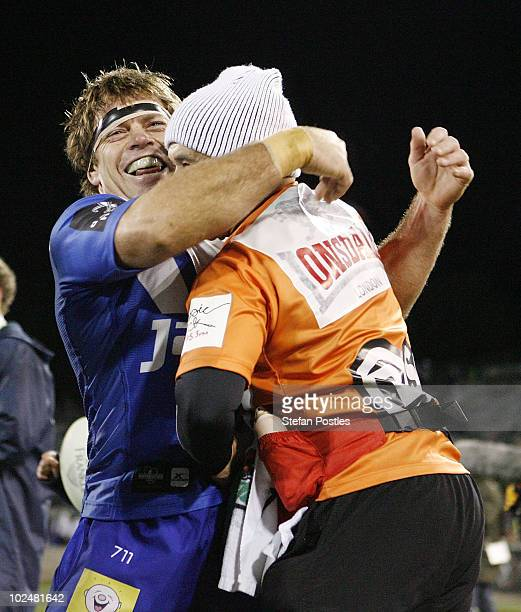 Brett Kimmorley of the Bulldogs celebrates with a trainer after winning the round 16 NRL match between the Canberra Raiders and the Canterbury...