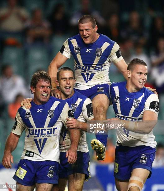 Brett Kimmorley of the Bulldogs celebrates with Steve Turner Josh Morris and Tim Browne after scoring the final try during the round six NRL match...