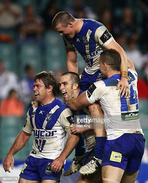 Brett Kimmorley of the Bulldogs celebrates with Steve Turner, Josh Morris and Tim Browne after scoring the final try during the round six NRL match...