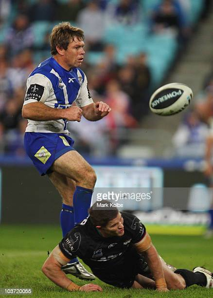 Brett Kimmorley of the Bulldogs has his attempted drop goal charged down the round 25 NRL match between the Canterbury Bulldogs and the Penrith...