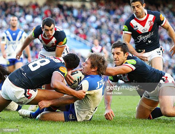 Brett Kimmorley of the Bulldogs is tackled in goal during the round 19 NRL match between the Sydney Roosters and the Canterbury Bulldogs at the...