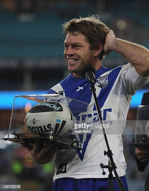 Brett Kimmorley of the Bulldogs laughs as he thanks the crowd after being presented with the match ball after his final home game during the round 25...