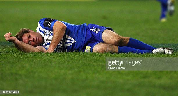 Brett Kimmorley of the Bulldogs lays on the ground after a heavy clash during the round 23 NRL match between the Canterbury Bulldogs and the Canberra...
