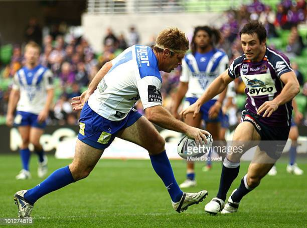 Brett Kimmorley of the Bulldogs puts the ball down for a try during the round 12 NRL match between the Melbourne Storm and the Canterbury Bulldogs at...