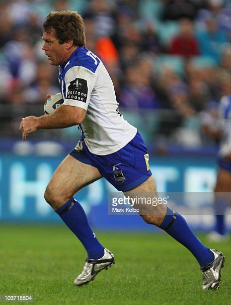 Brett Kimmorley of the Bulldogs runs the ball during the round 25 NRL match between the Canterbury Bulldogs and the Penrith Panthers at ANZ Stadium...