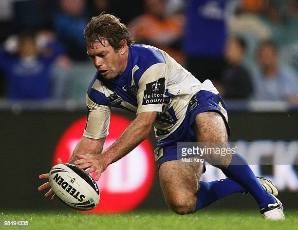 Brett Kimmorley of the Bulldogs scores the final try during the round six NRL match between the Wests Tigers and the Canterbury Bulldogs at the...