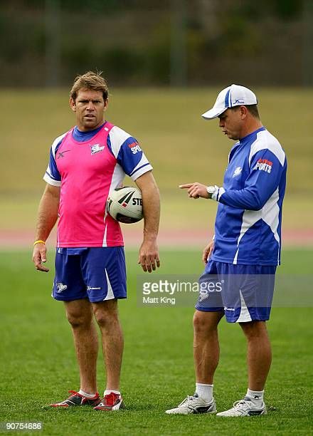 Brett Kimmorley talks to Bulldogs coach Kevin Moore during a Bulldogs NRL training session at Sydney Olympic Park on September 15 2009 in Sydney...