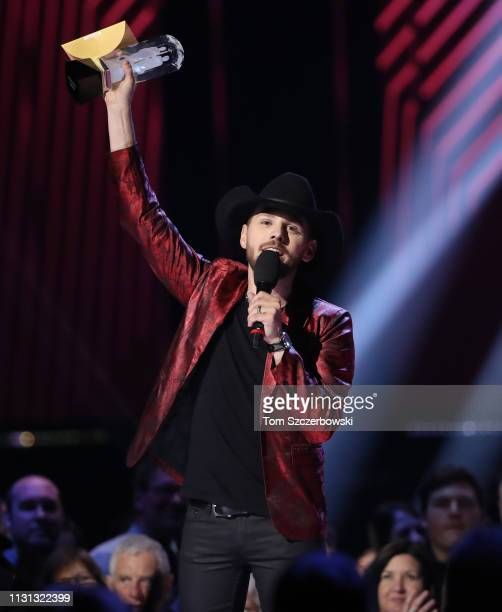 Brett Kissel holds up his award after winning the Country Album of the Year during the 2019 Juno Awards at Budweiser Gardens on March 17 2019 in...