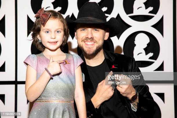 Brett Kissel walks the red carpet with St Jude patient Londyn during Country Cares for St Jude Kids Seminar at The Peabody on January 17 2020 in...