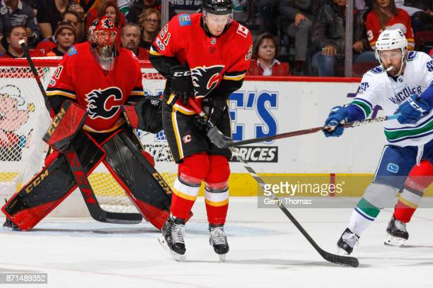 Brett Kulak of the Calgary Flames takes a shot in an NHL game against the Vancouver Canucks at the Scotiabank Saddledome on November 7 2017 in...