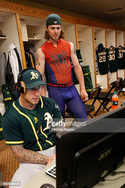 Brett Lawrie and Josh Reddick of the Oakland Athletics studies video in the clubhouse prior to the game against the San Francisco Giants at ATT Park...