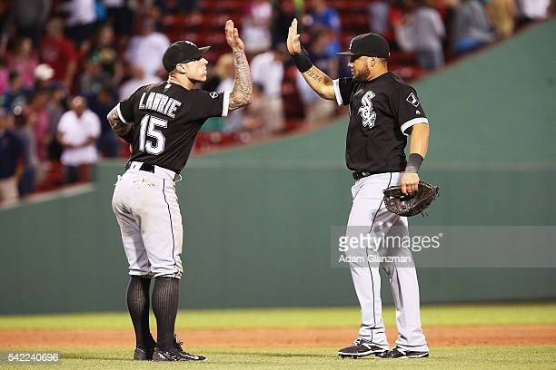 Brett Lawrie high fives Melky Cabrera of the Chicago White Sox after a victory over the Boston Red Sox at Fenway Park on June 22 2016 in Boston...