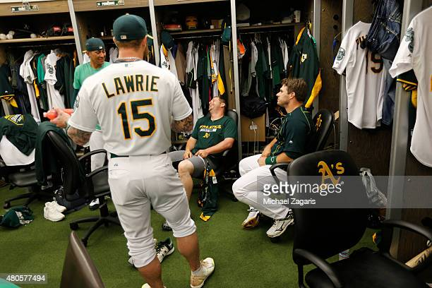 Brett Lawrie Jesse Chavez Stephen Vogt and Josh Phegley of the Oakland Athletics joke around in the clubhouse prior to the game against the Seattle...