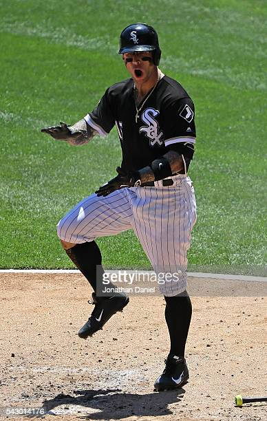 Brett Lawrie of the Chicago White Sox celebrates his solo home run in the 2nd inning against the Toronto Blue Jays at US Cellular Field on June 25...
