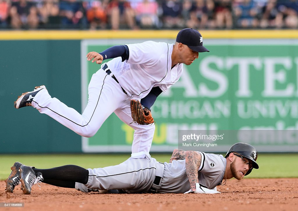 Brett Lawrie #15 of the Chicago White Sox dives back to the base to avoid the tag of Jose Iglesias #1 of the Detroit Tigers during the game at Comerica Park on June 3, 2016 in Detroit, Michigan. The Tigers defeated the White Sox 10-3.