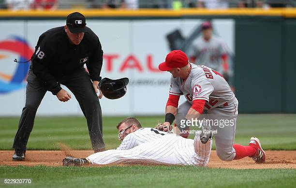 Brett Lawrie of the Chicago White Sox dives safely into second base with a double ahead of the tag by Johnny Giavotella of the Los Angeles Angels in...