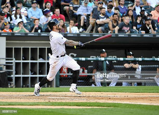 Brett Lawrie of the Chicago White Sox hits a threerun homer against the Cleveland Indians during the fifth inning in the first game of a doubleheader...