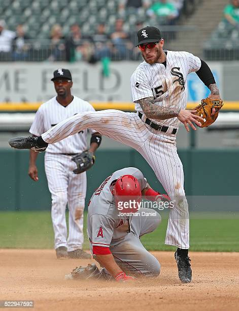 Brett Lawrie of the Chicago White Sox leaps over Mike Trout of the Los Angeles Angels to turn a double play in the 8th inning at US Cellular Field on...