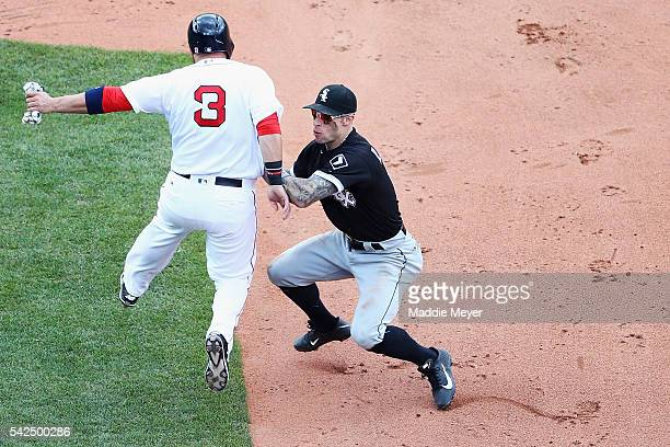 Brett Lawrie of the Chicago White Sox tags out Sandy Leon of the Boston Red Sox during the sixth inning at Fenway Park on June 23 2016 in Boston...