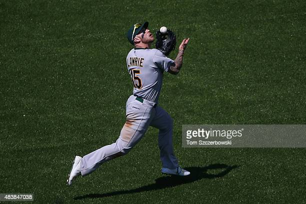 Brett Lawrie of the Oakland Athletics catches a pop up in the eighth inning during MLB game action against the Toronto Blue Jays on August 13 2015 at...