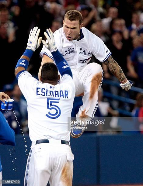 Brett Lawrie of the Toronto Blue Jays celebrates his gamewinning home run in the 9th inning with Yunel Escobar of the Toronto Blue Jays against the...