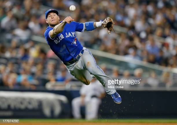 Brett Lawrie of the Toronto Blue Jays fields a ground ball for an out against the New York Yankees during the second game of a doubleheader at Yankee...