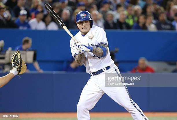 Brett Lawrie of the Toronto Blue Jays is hit by pitch in the sixth inning during MLB game action against the Baltimore Orioles on April 22 2014 at...