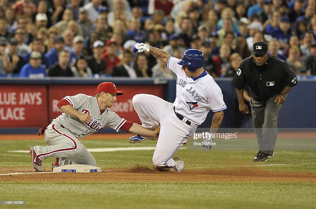 Brett Lawrie #13 of the Toronto Blue Jays is tagged out trying to steal third base by Mike Fontenot #18 of the Philadelphia Phillies during interleague MLB game action June 15, 2012 at Rogers Centre in Toronto, Ontario, Canada.