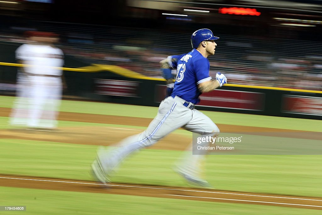 Brett Lawrie #13 of the Toronto Blue Jays runs to first base on a foul ball hit against the Arizona Diamondbacks during the interleague MLB game at Chase Field on September 3, 2013 in Phoenix, Arizona.