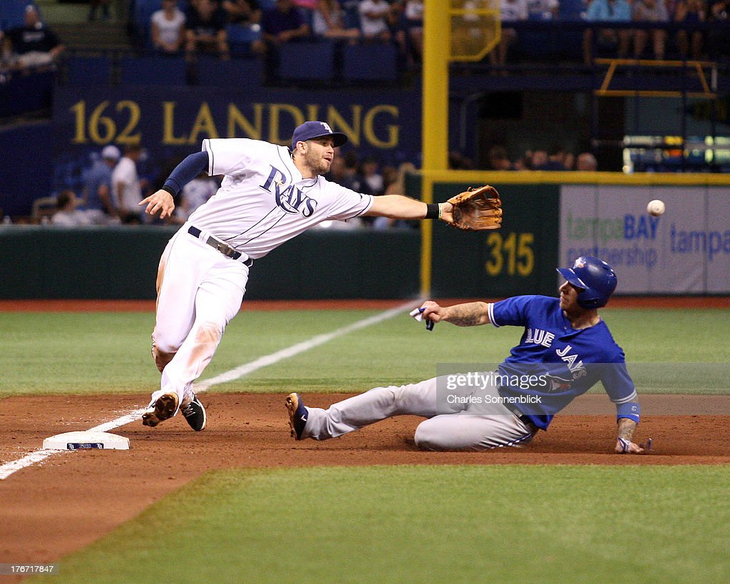 Brett Lawrie #13 of the Toronto Blue Jays steals 3rd base in the sixth inning beating the throw to Evan Longoria #3 of the Tampa Bay Rays during the game on August 17, 2013 at Tropicana Field in St. Petersburg, Florida.