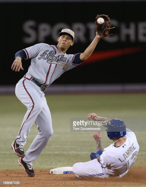 Brett Lawrie of the Toronto Blue Jays steals second base in the sixth inning during MLB game action as Andrelton Simmons of the Atlanta Braves waits...