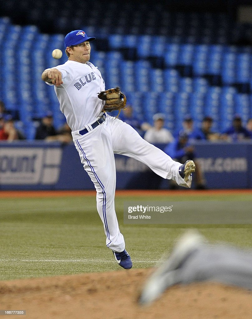 Brett Lawrie #13 of the Toronto Blue Jays throws to first base during MLB-game action against the Chicago White Sox April 16, 2013 at Rogers Centre in Toronto, Ontario, Canada.