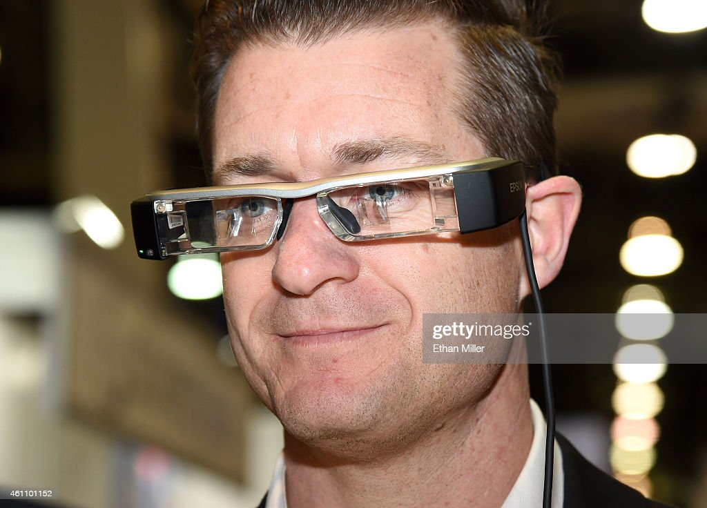 Brett Leary tries out Epson's BT-200 Moverio smart glasses at the 2015 International CES at the Sands Expo and Convention Center on January 6, 2015 in Las Vegas, Nevada. The USD 699 augmented reality glasses have a front-facing camera for video capture and virtual reality gaming. CES, the world's largest annual consumer technology trade show, runs through January 9 and is expected to feature 3,600 exhibitors showing off their latest products and services to about 150,000 attendees.