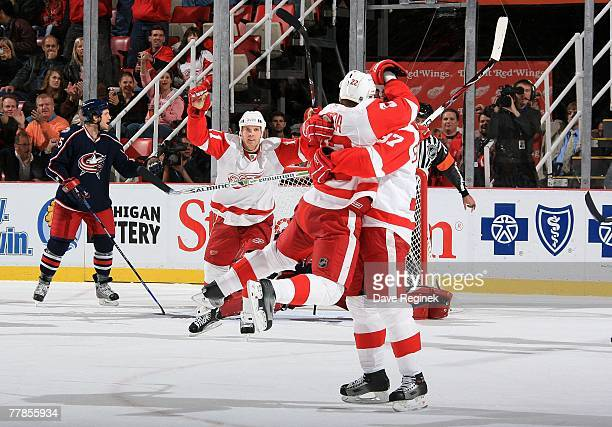 Brett Lebda jumps into the arms of teammate Mikael Samuelsson after Dan Cleary of the Detroit Red Wings first period goal on Pascal Leclaire of the...