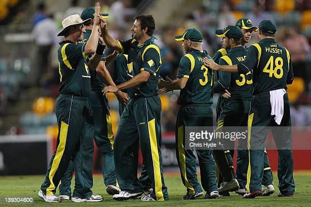 Brett Lee and Ben Hilfenhaus of Australia celebrate winning game seven of the One Day International series between Australia and India at The Gabba...