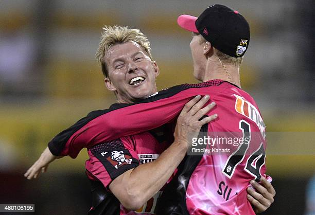 Brett Lee and Jordan Silk of the Sixers celebrate after Jordan Silk takes a spectacular catch to dismiss Craig Kieswetter of the Heat during the Big...