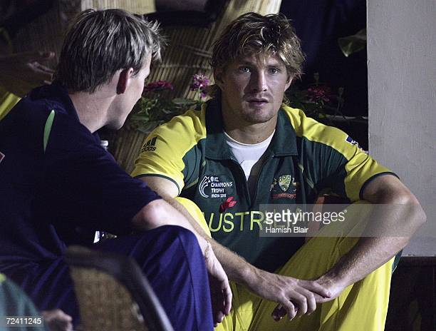 Brett Lee and Shane Watson of Australia chat outside the dressing rooms as rain delays play during the final of the ICC Champions Trophy between...