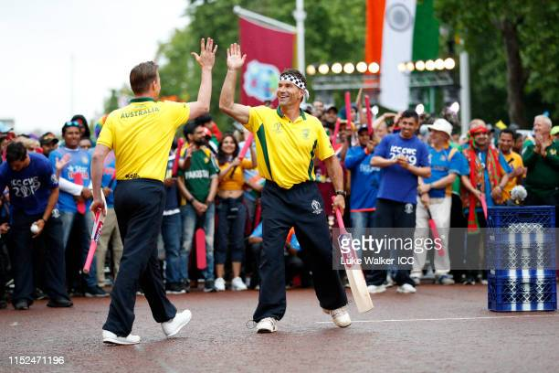 Brett Lee of Australia and Pat Cash of Australia high five during the ICC Cricket World Cup 2019 Opening Party at The Mall on May 29 2019 in London...