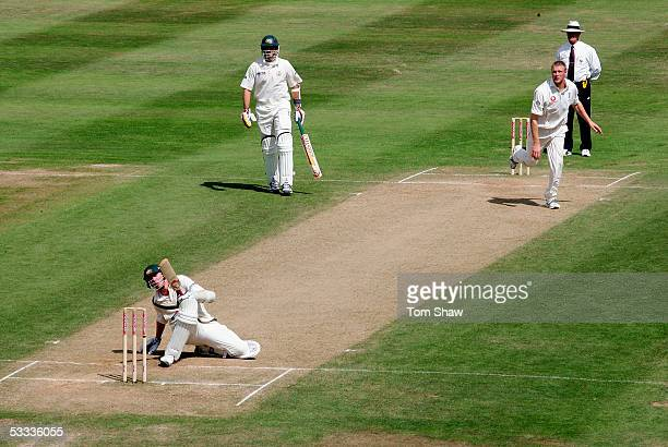 Brett Lee of Australia avoids a bouncer from Andrew Flintoff of England during day four of the Second npower Ashes Test match between England and...