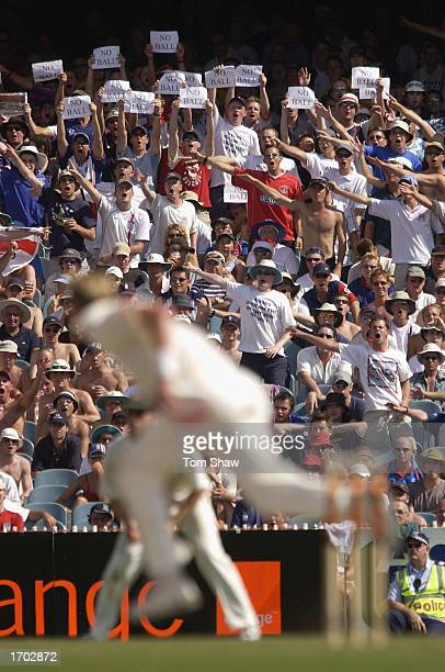 Brett Lee of Australia bowls as the Barmy Army signal a no ball during the third day of the fourth Ashes Test between Australia and England at the...