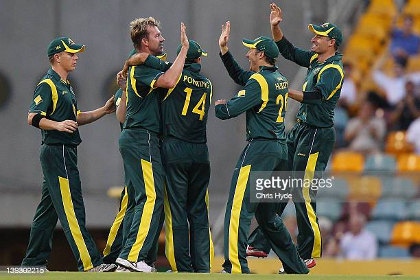 Brett Lee of Australia celebrates with team mates after taking dismissing Rohit Sharm of India during game seven of the One Day International series...