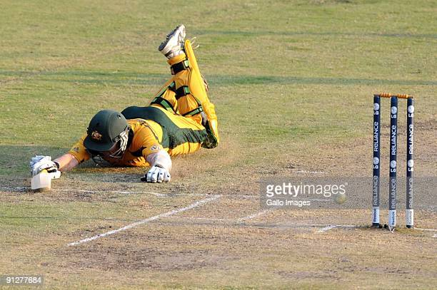 Brett Lee of Australia dives for the winning run during the ICC Champions Trophy match between Australia and Pakistan at SuperSport Park on September...