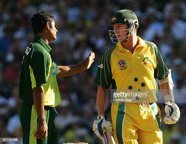 Brett Lee of Australia glares at Abdul Razzaq of Pakistan after receiving a head high full toss the delivery lead to Razzaq being banned from bowling...