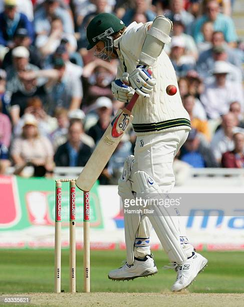 Brett Lee of Australia is struck on the elbow by a ball from Andrew Flintoff of England during day four of the Second npower Ashes Test between...