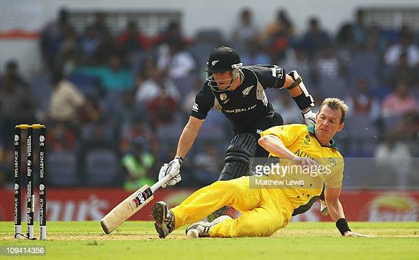 Brett Lee of Australia looks to run out Brendon McCullum of New Zealand during the 2011 ICC World Cup Group A match between Australia and New Zealand...