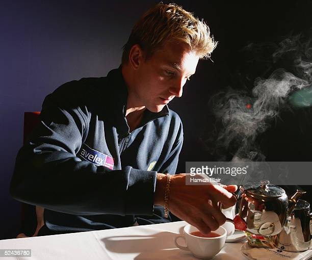 Brett Lee of Australia pours himself some tea during a press conference at the Intercontinental Hotel on March 17 2005 in Wellington New Zealand